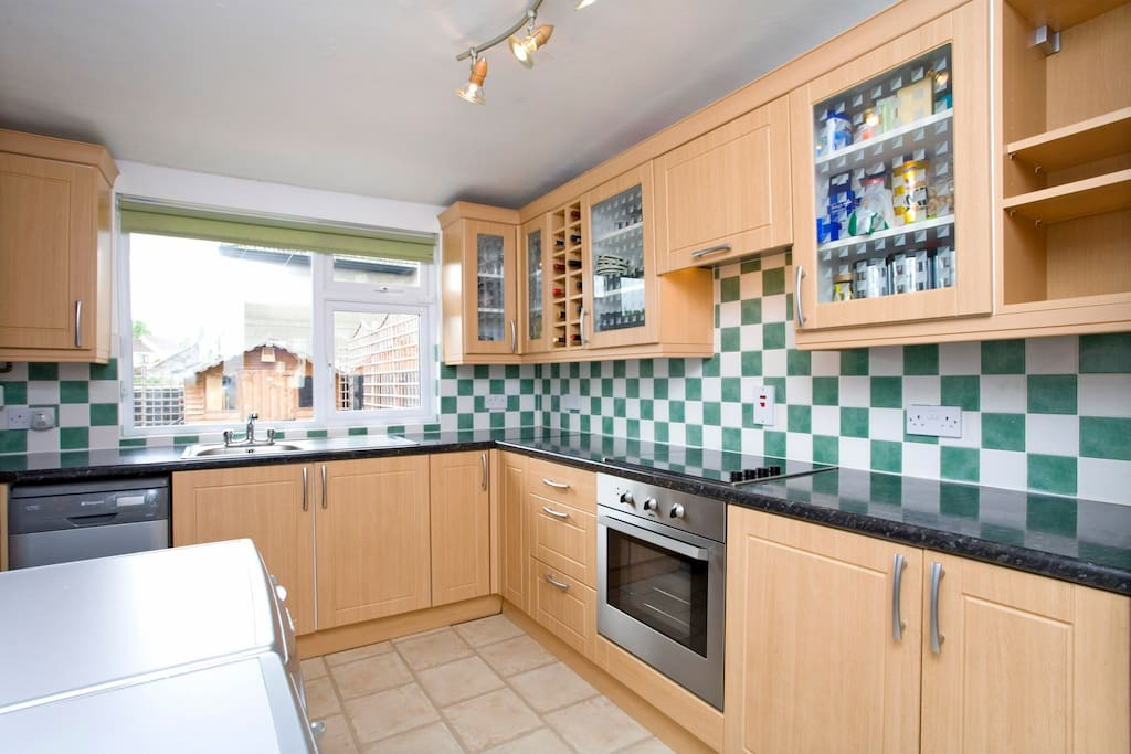 Kitchen with all mod cons - washing machine, dryer, dishwasher, oven, toaster and kettle.