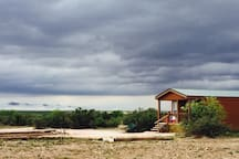 The Cabin sits on a high point and therefore has a beautiful view of neighboring farms and ranches.