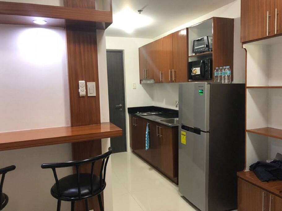 Kitchen with Refrigerator, Microwave, toaster oven, Electric kettle, Rice Cooker, Stove and other basic kitchen utensils