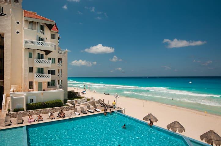 Beach front Condo @ Playa Delfines