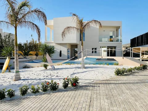 Luxury villa with own beach by the large pool