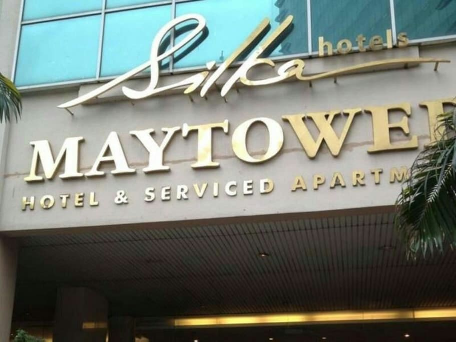 The building name is Maytower Hotel & Serviced Apartment.