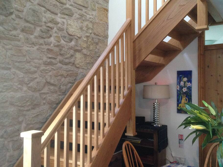 Handmade Oak Staircase up to the Double Bedrooms and second bathroom. Views upstairs over the Henderson Park down the River Tweed.
