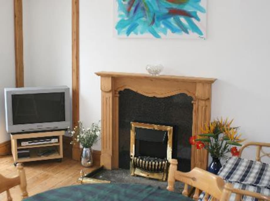 Sitting room with tv and free view channels. Open plan kitchen area with everything you will need. Seating for up to 6 people.