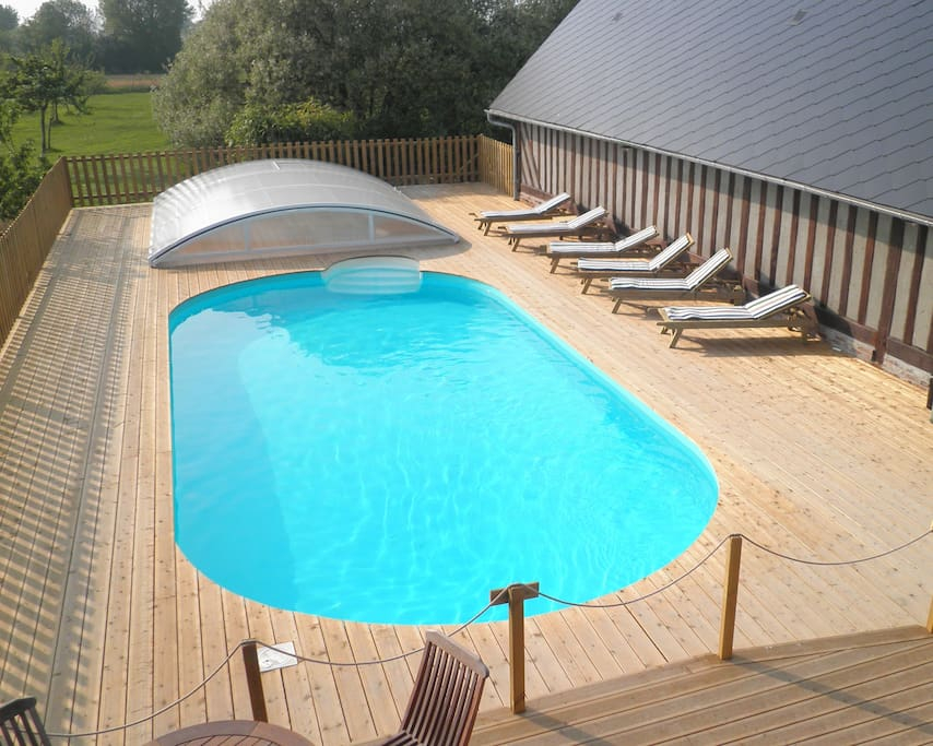 Swimming pool, heated and cover for use on cooler days