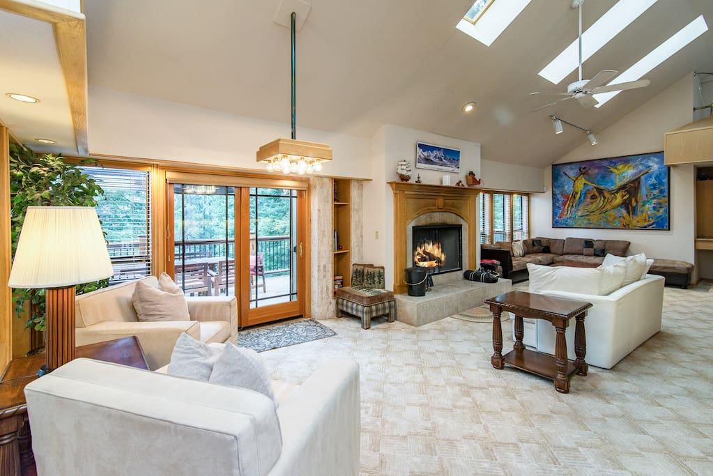 High ceilings and natural light frame the living area.