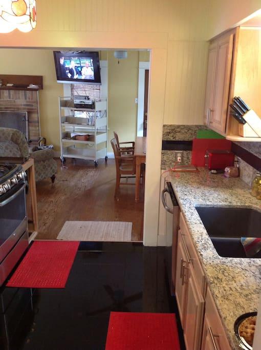 Kitchen W/ granite countertops and backsplash