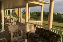 "Bring your glass of wine and enjoy the ""front porch sitting"""