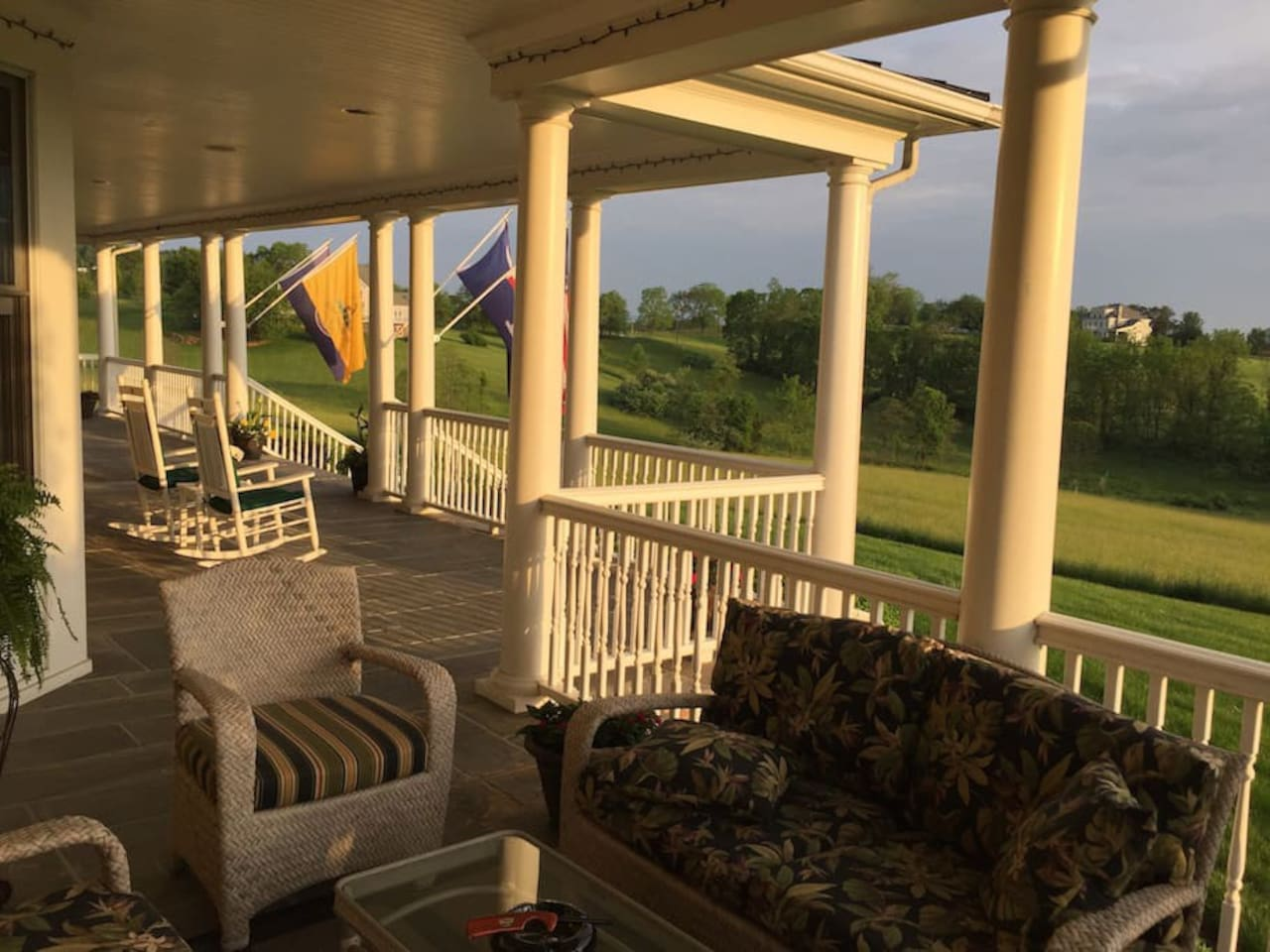"""Bring your glass of wine and enjoy the """"front porch sitting"""""""