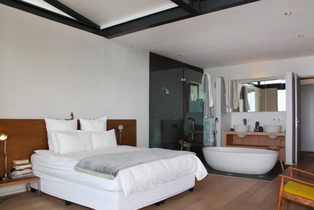 Main bedroom upstairs with view to en suite bathroom