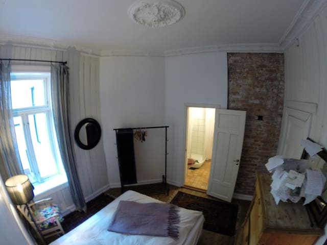 Wiev of room facing shared bathroom with your own door.
