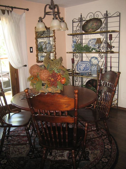 Dining room for your breakfast.  Fresh air on balcony that is furnished with table and chairs.  Small grill if needed located on balcony overlooking Live Oak Trees and pasture.