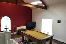 "Pool table 7""x4"", Table tennis, board games, Freeview TV, sofa bed."