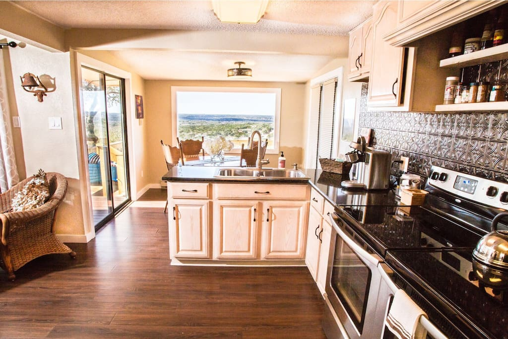 Second Fully Stocked Kitchen at The Nest with a gorgeous view from the picture window
