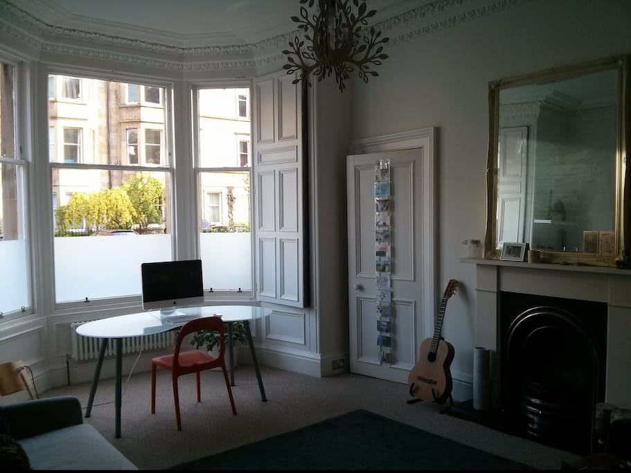 Study/ Double bedroom 2 with large bay window and working fireplace