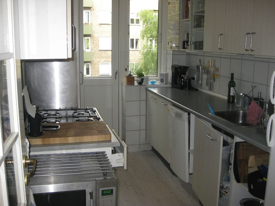 The kitchen with a small balcony