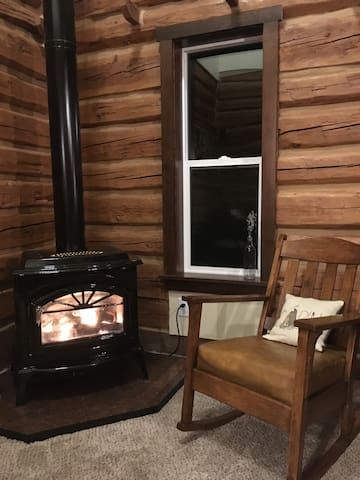 Cozy up to the propane fireplace in the mission style antique rocker. Custom hearth made from lucky pennies!