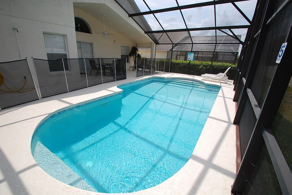 Pool with removable child safety pool enclosure fence