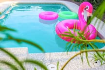 Enjoy the pool on a hot day. Please provide your own pool toys.