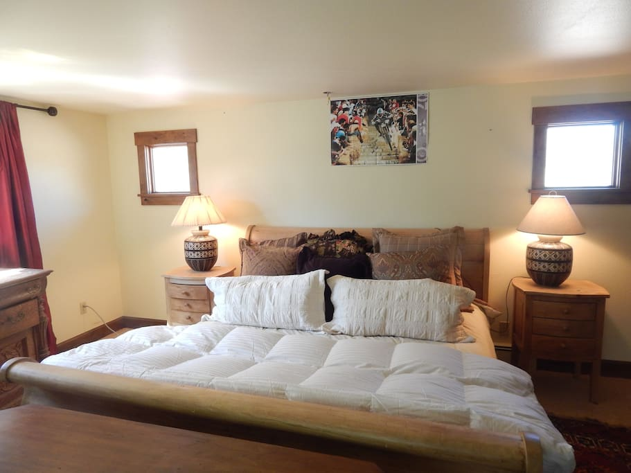 Guest Master Suite with additional trundle bed and fireplace.