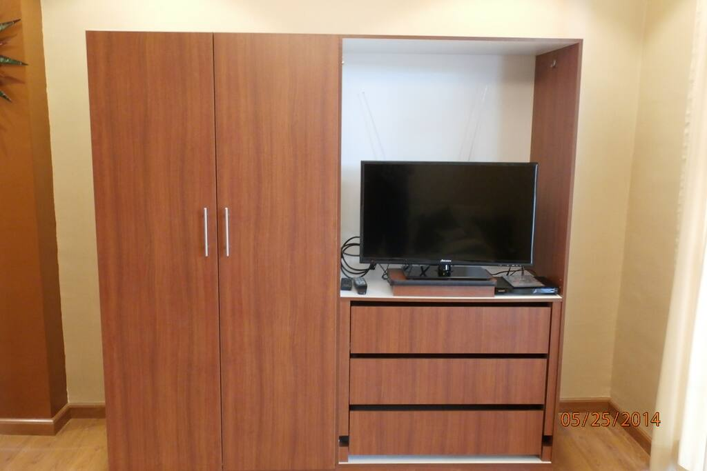 Flat screen TV with DVD player and HDMI cable.