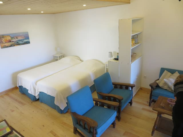 Sleeping area with two beds