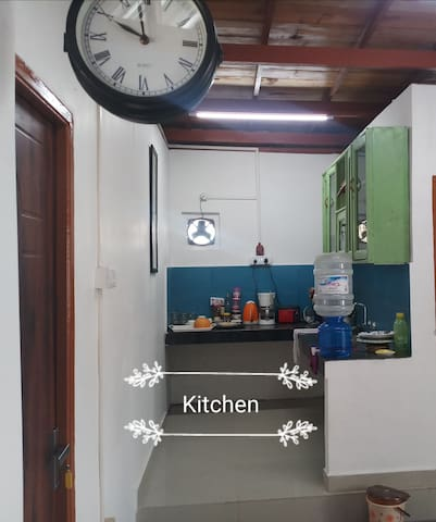 Kitchen with all essential utilities including coffee brewer, kettle, bread toaster and egg boiler