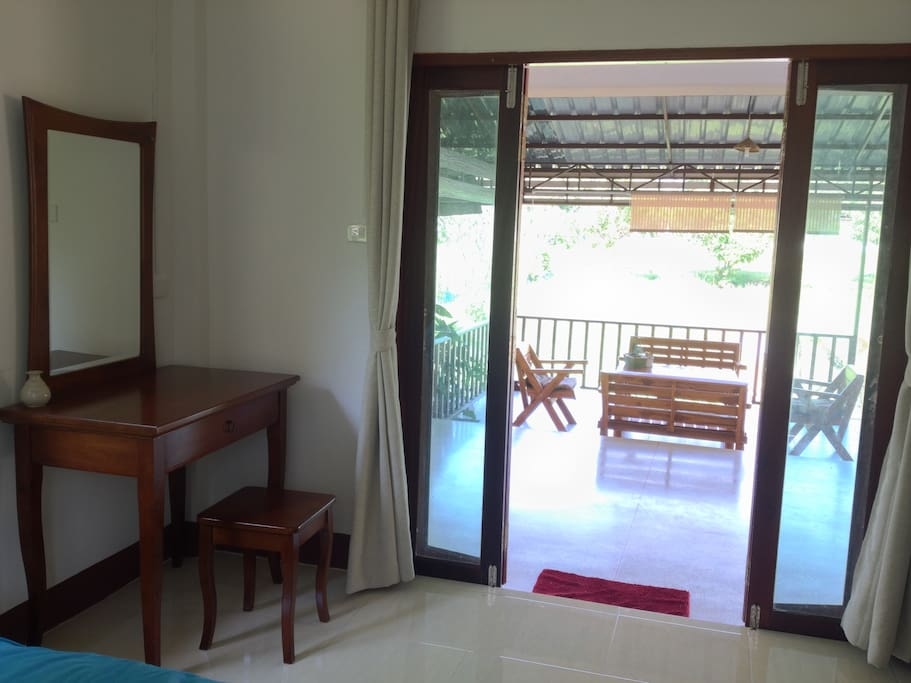 Inside bedroom - Dressing table on the right and look out to the pond where 7 metres wide balcony is in front of your room!