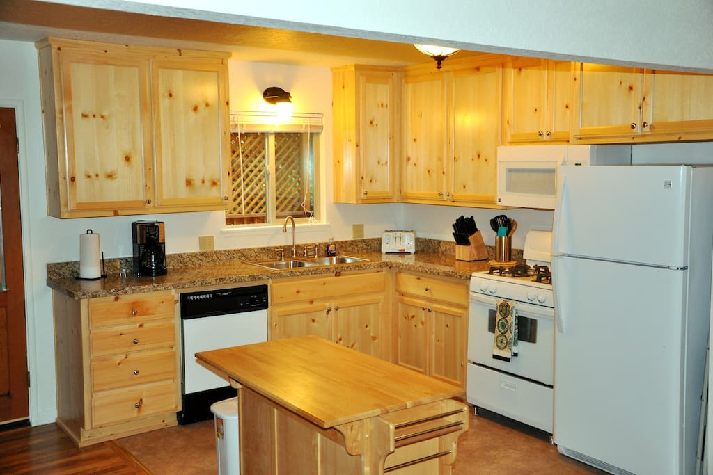 Classic Kitchen with granite counters and knotty pine cabinets