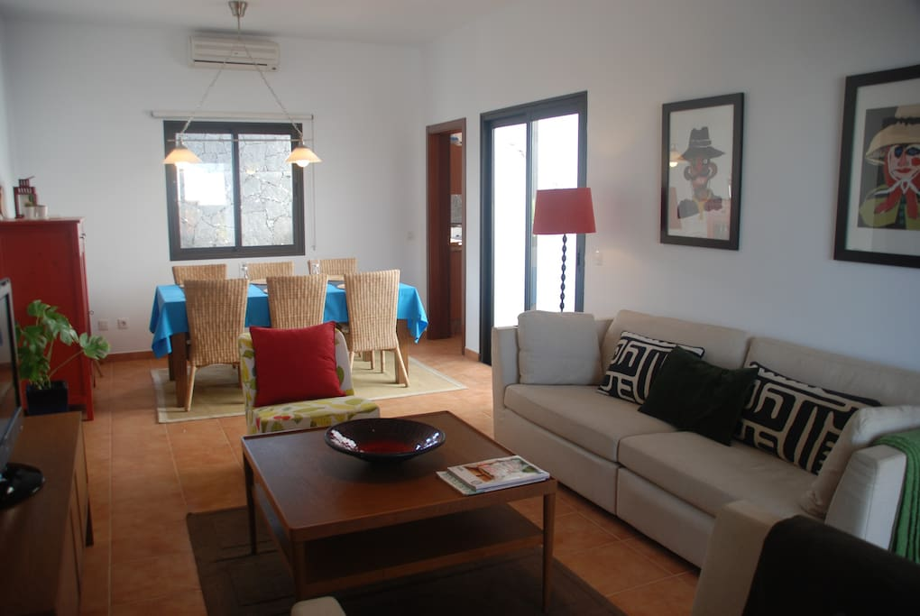 Our dining & livingroom is open and full of natural light with access to the pool area