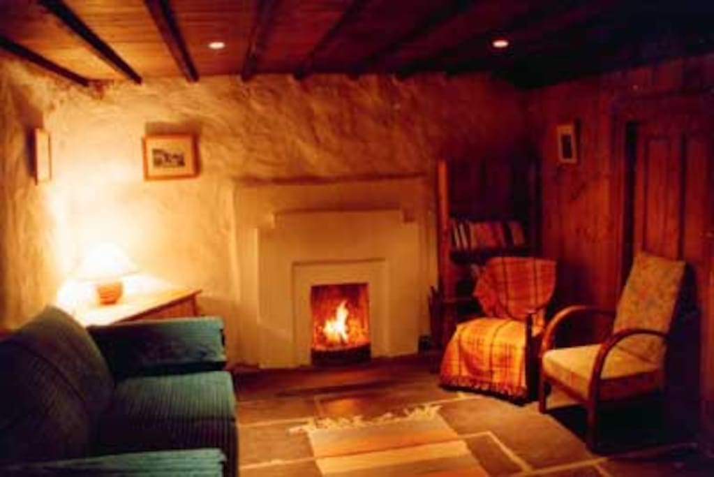 Sittingroom with open fire.