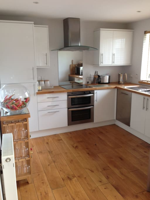 Fully fitted kitchen with cooker, hob, microwave, fridge/freezer, dishwasher, washing maching/dryer.