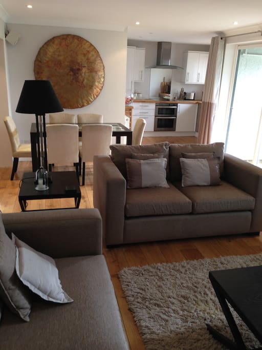 Large elegant open plan lounge with dining area, equipped with all the latest technology including 42' Plasma TV, CD player, PlayStation 2, I-Pod and Dock, and a library of CDs, DVDs, books and games.