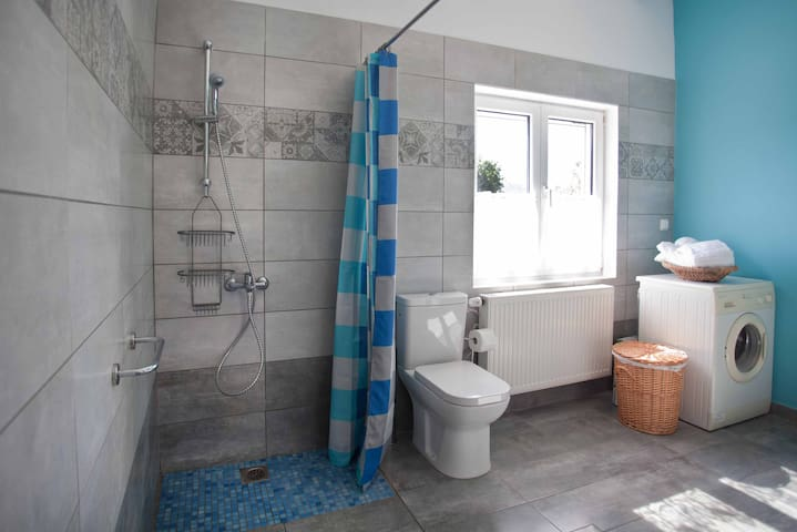 Wheel-in shower suitable for wheelchairs. Shower stool available.