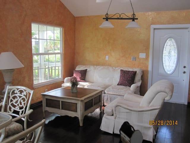 Cozy and spacious living room with view of Allen Creek.