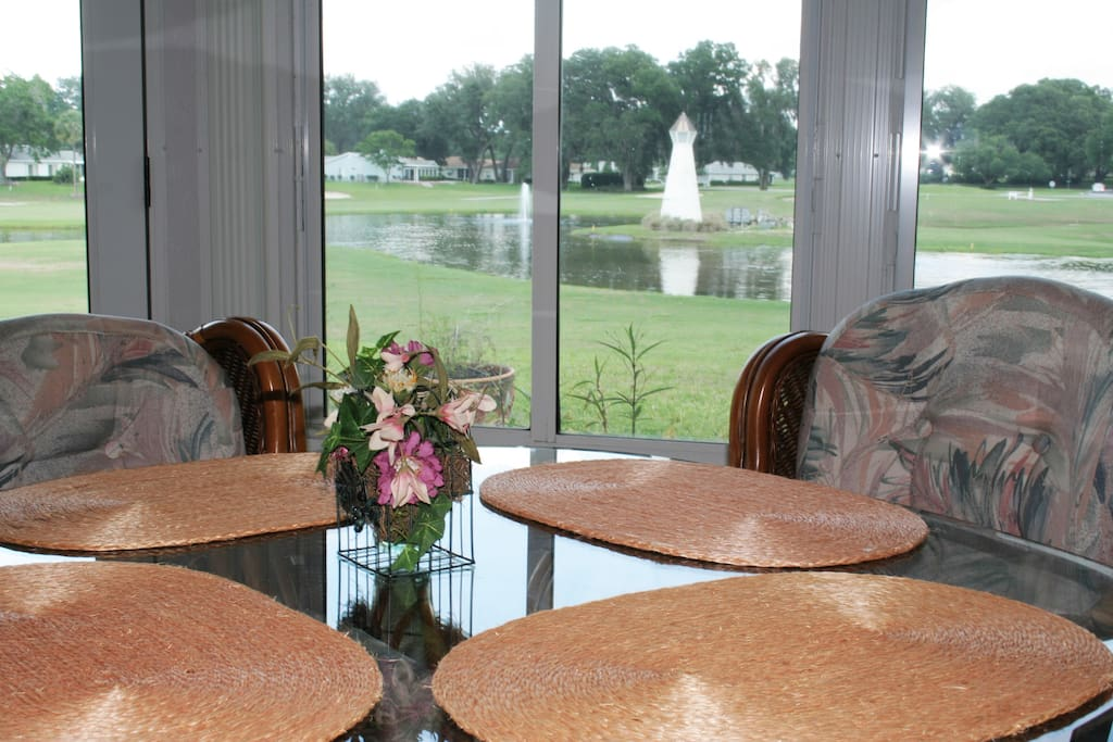View of pond off dining area in all season Florida room