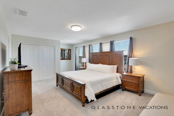 En-suite Master bedroom featuring a King size bed, TV and large closet.