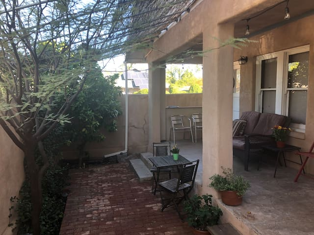 Shaded front porch with love seat and lots of seating to enjoy the beautiful Tucson sunsets.
