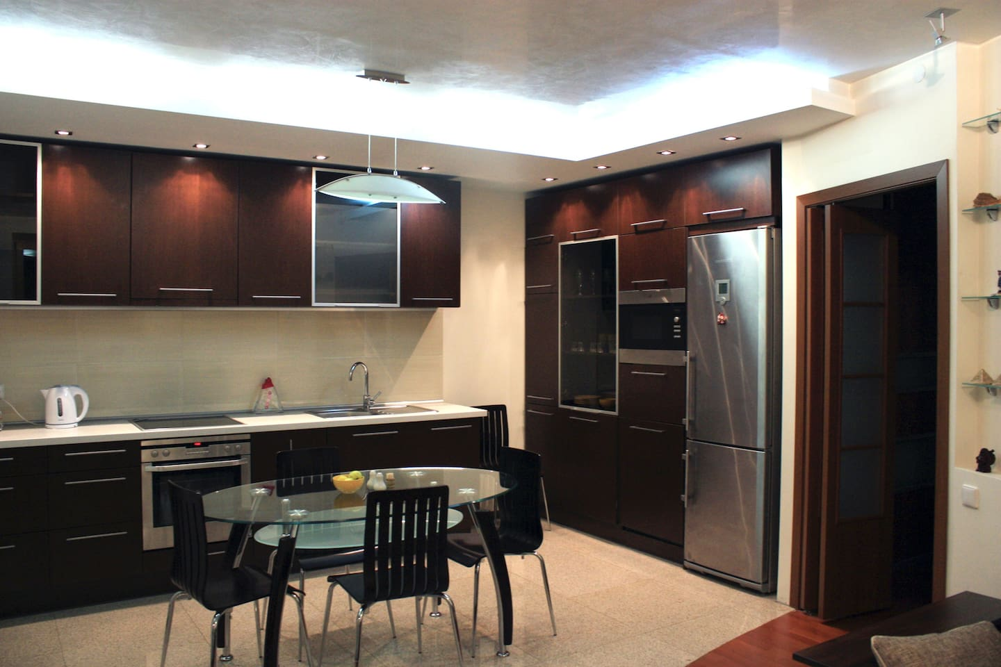 Fully equipped kitchen: cooking plates, oven, kettle,  microwave oven, dishwasher, washing machine, huge fridge