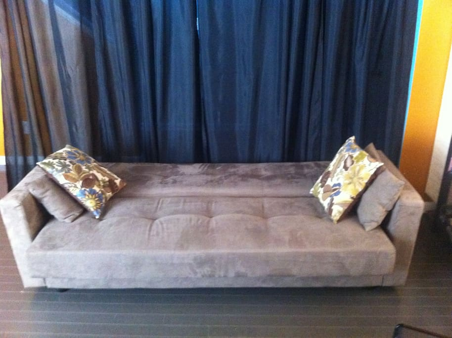 Futon lets out into a sleeper.  Air mattress, pillow, & linens available.  Black privacy curtain.