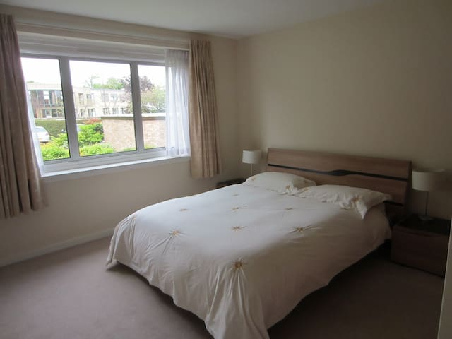 Main bedroom with king size bed and fitted wardrobes