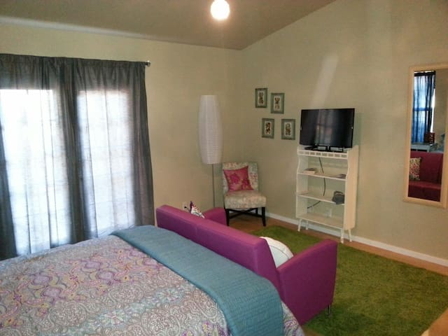 Flat screen TV and high speed internet. French doors open to a private patio and fenced yard for your pet.