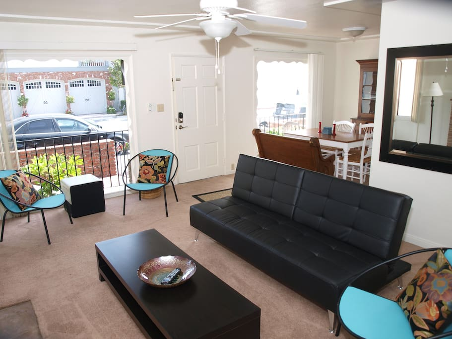 Living Room with Futon Sofa has Flat Screen TV.  WiFi included.