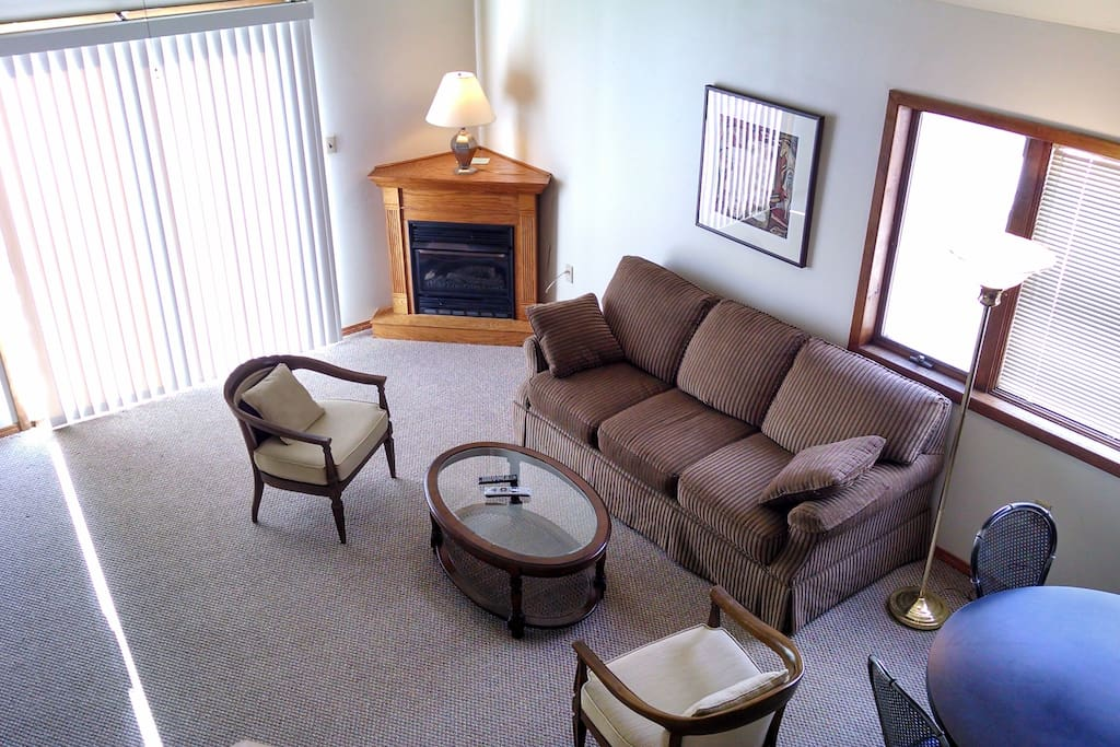 View of living room with sliding door to deck view