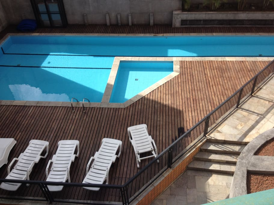 A swimming pool and a great place to chill out in the sun
