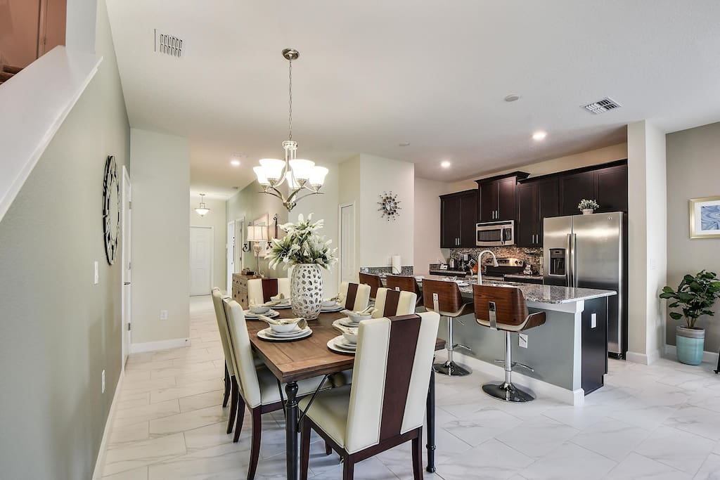 Located off the main living space, this contemporary styled dining room area has seating for up to 6 guests to sit and enjoy dinners together.