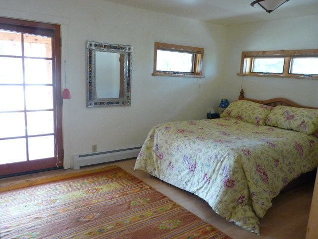 guest bedroom opens onto front porch