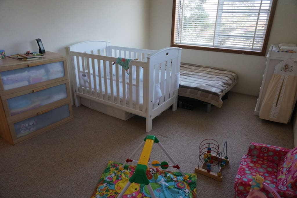 Baby cot, change table and plenty of toys!