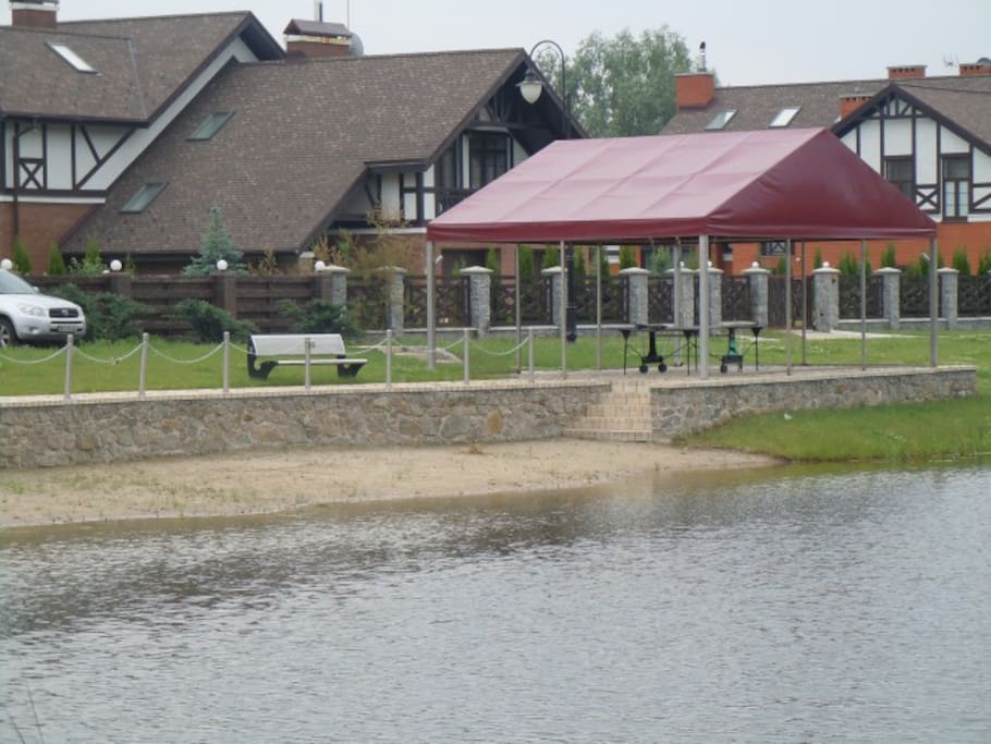 Community meeting place and mini-beach beside the lake