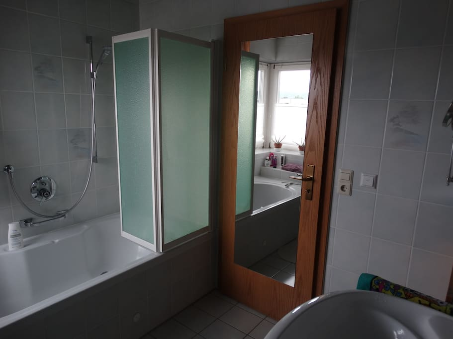 Your own adjacent bathroom with tub and shower